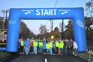 Group shot of the Columbus Running Company volunteers at the Columbus Marathon mile 6 water stop